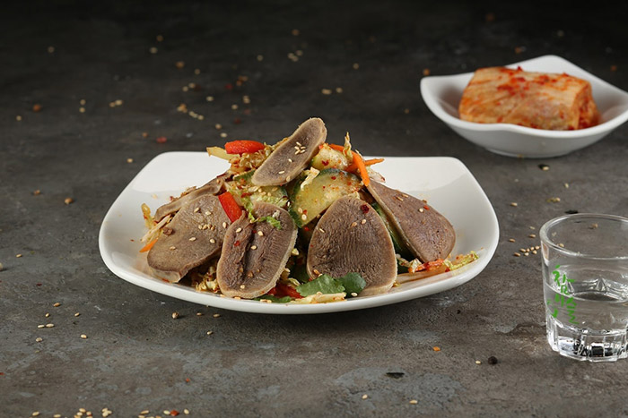 Beef tongue salad with vegetables